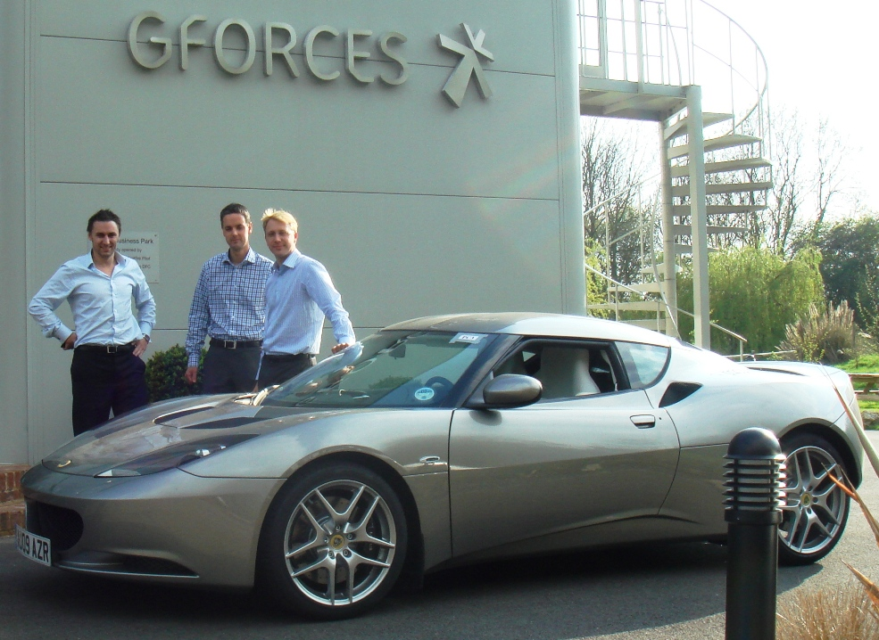 G-Forces' Tim Smith (l), Jamie Dixon (r) and James Haskey of Lotus UK (centre) with the new Evora