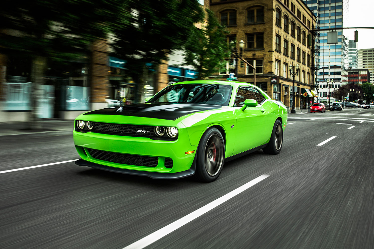 Dodge Challenger Hellcat in 'Go Green' on a suburban street.