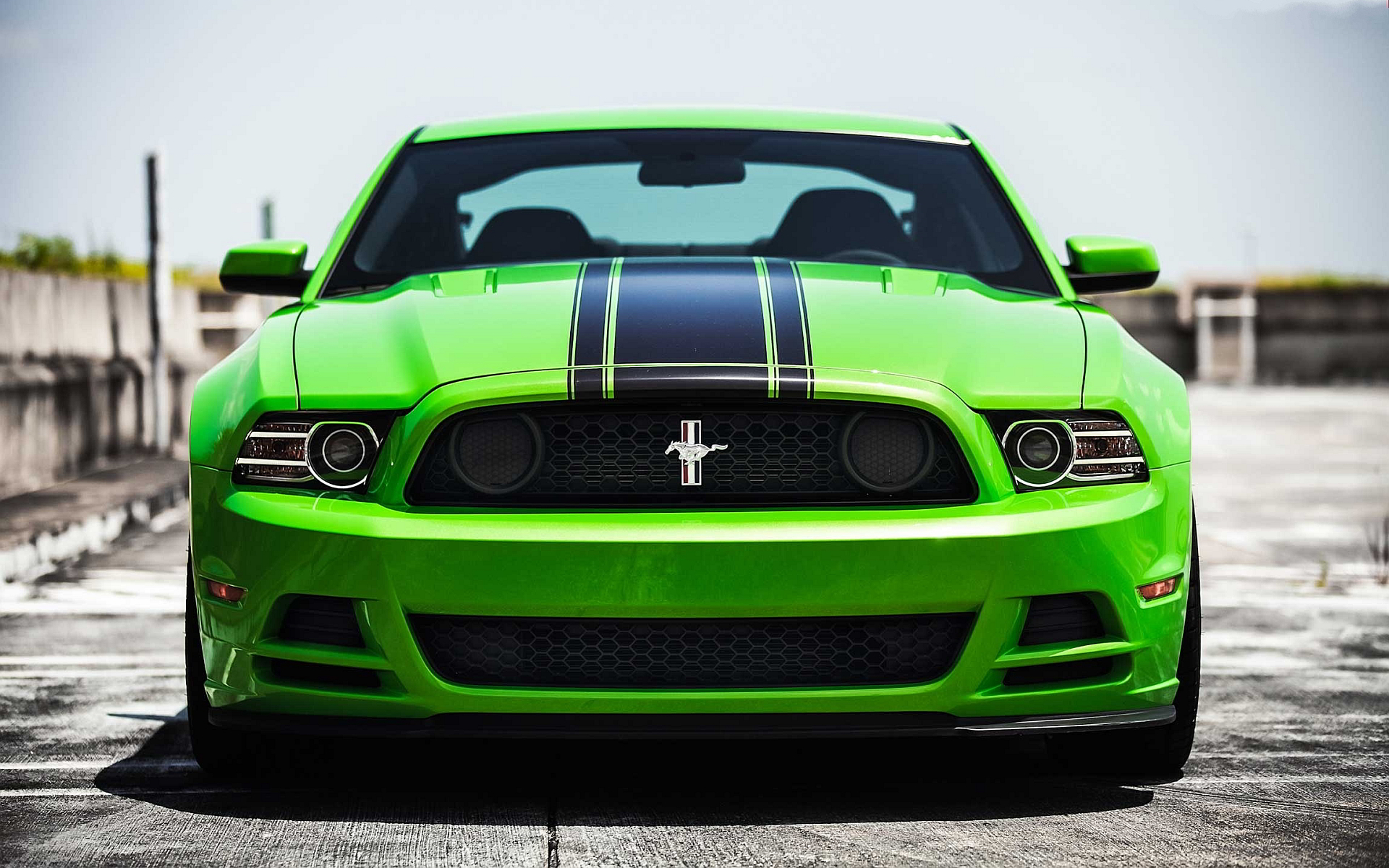 2013 Ford Mustang Boss 302, on runway, in 'Gotta Have It Green'.