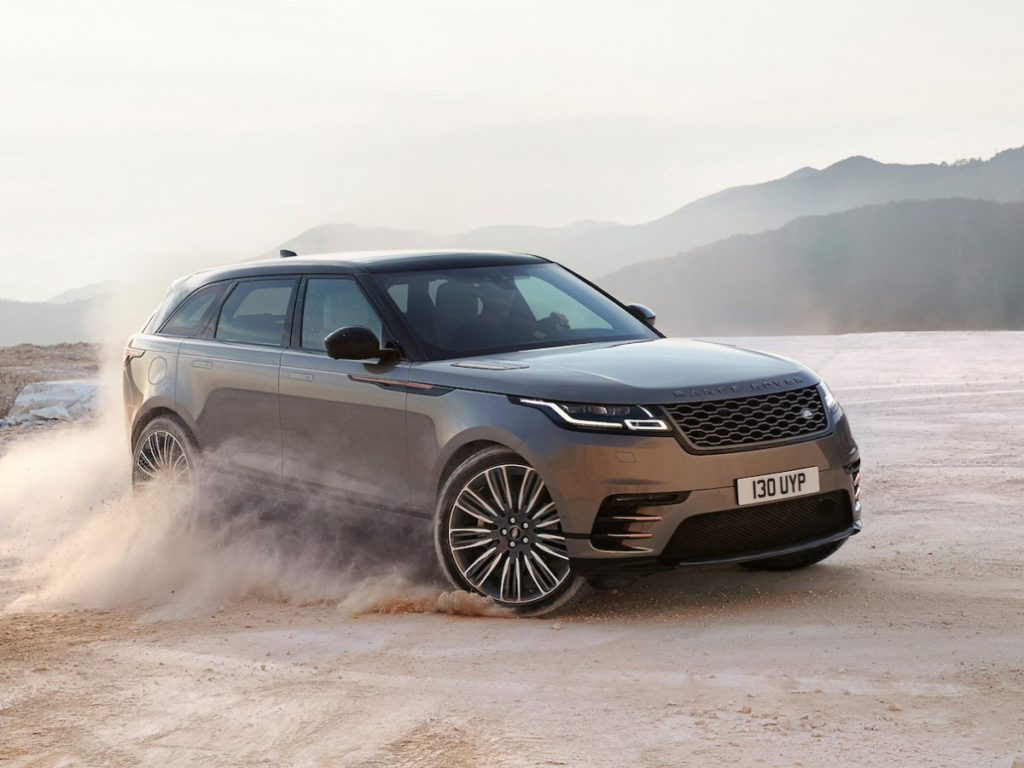 The new Range Rover Velar, driving through a desert.